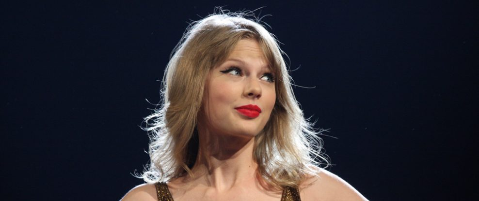 Taylor Swift Serenades Engaged Couple