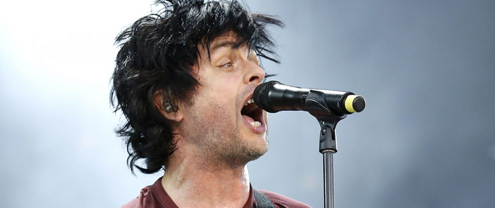 Billie Joe Armstrong Tosses His Guitar In A Pool At Cannes Show